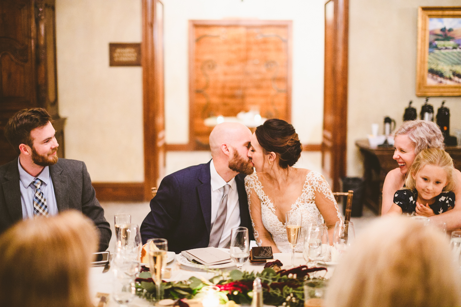 037 - bride and groom share a kiss at their intimate reception.jpg