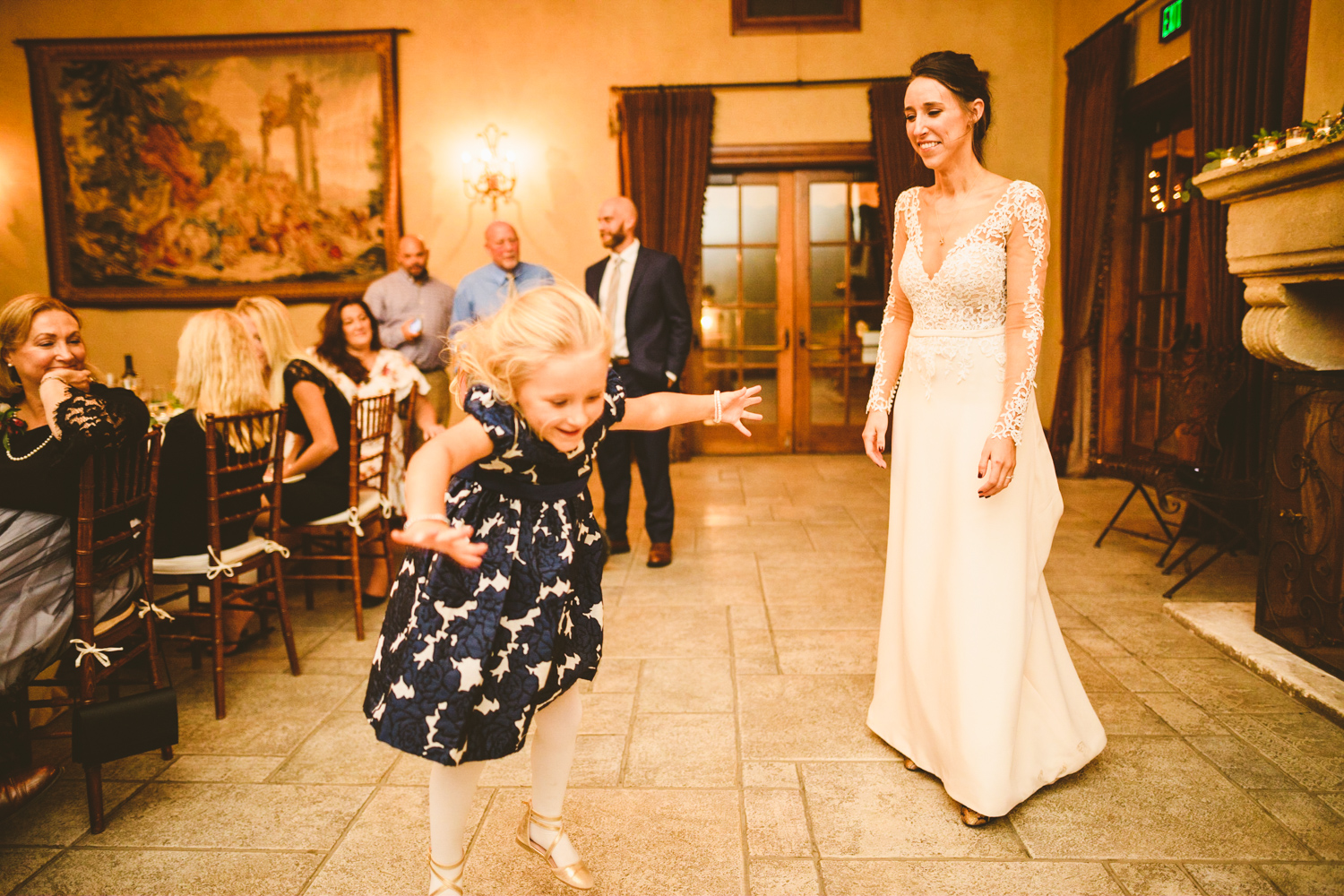 038 - daughter of the bride jumps around at the reception.jpg