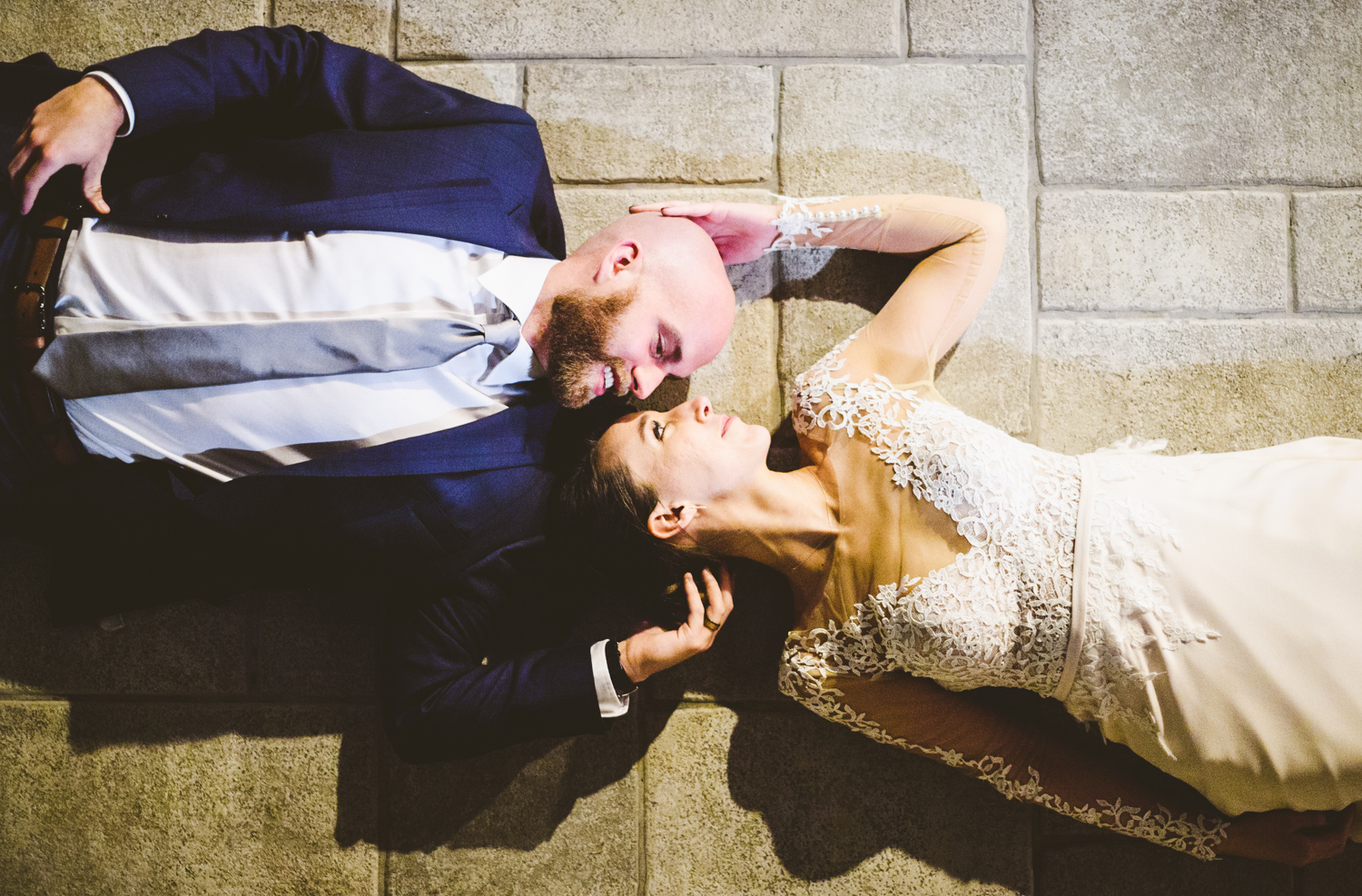 039 - night portrait of bride and groom laying down.jpg