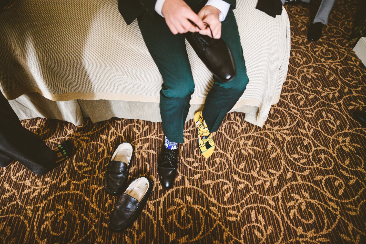 001 - groom putting on star wars themed socks.jpg