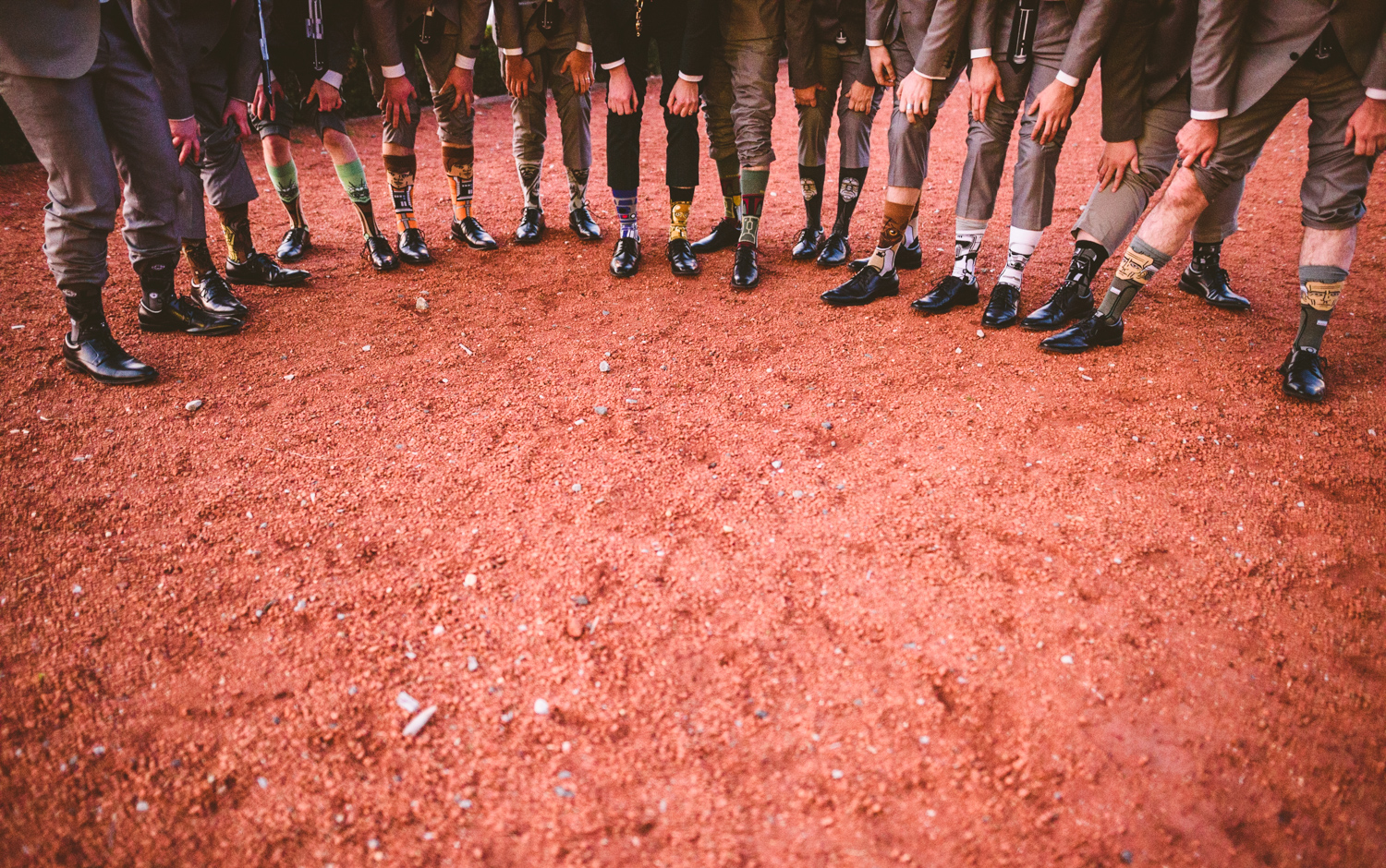 025 - groomsmen showing off their star wars socks.jpg