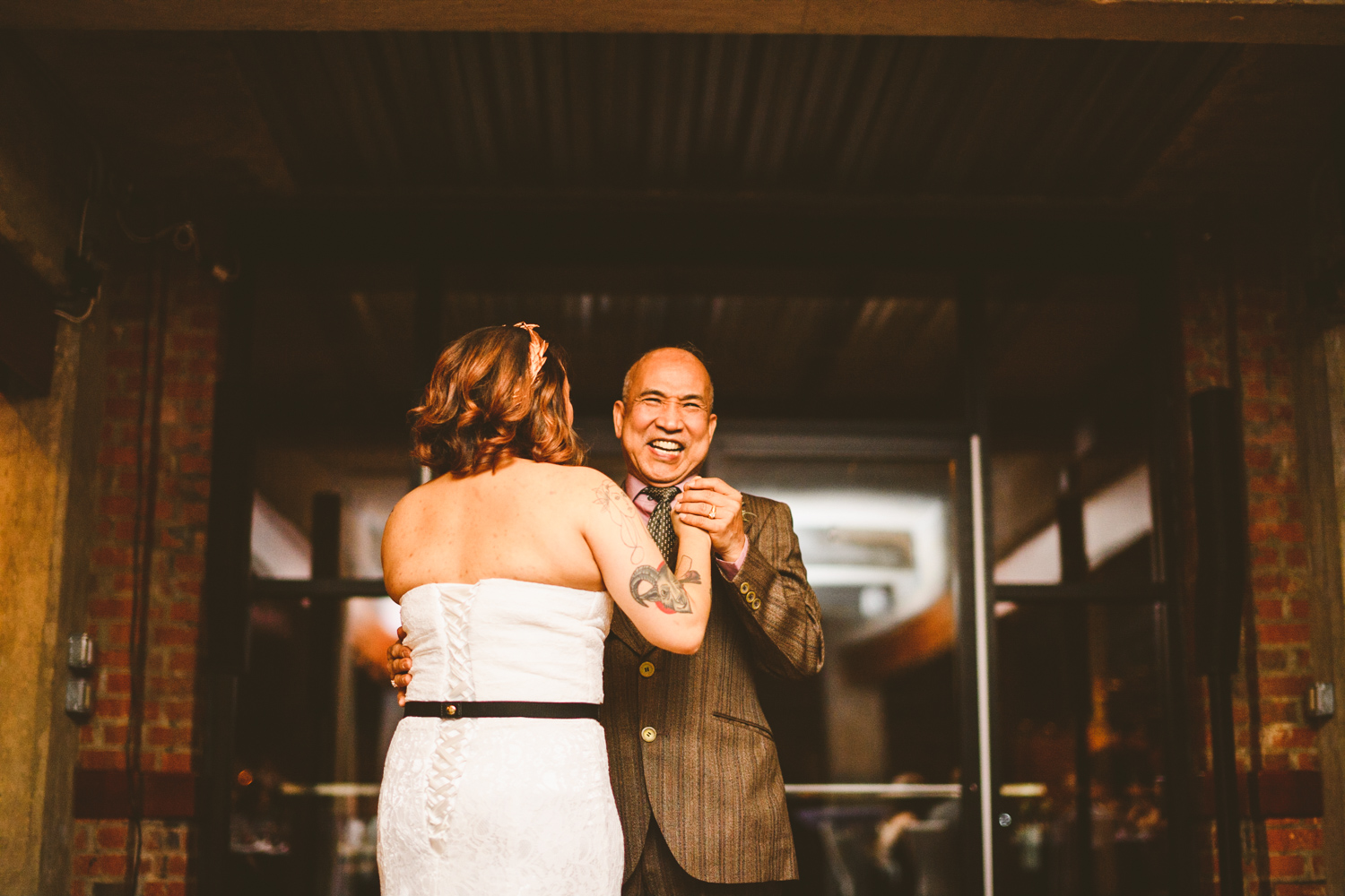 032 - bride's dad laughs during the father daughter dance.jpg