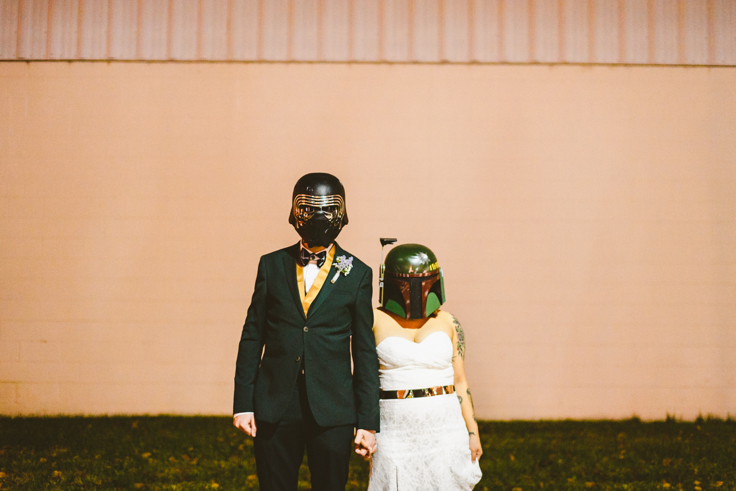 044 - bride and groom pose with kylo ren and boba fett helmets on in richmond virginia star wars wedding.jpg