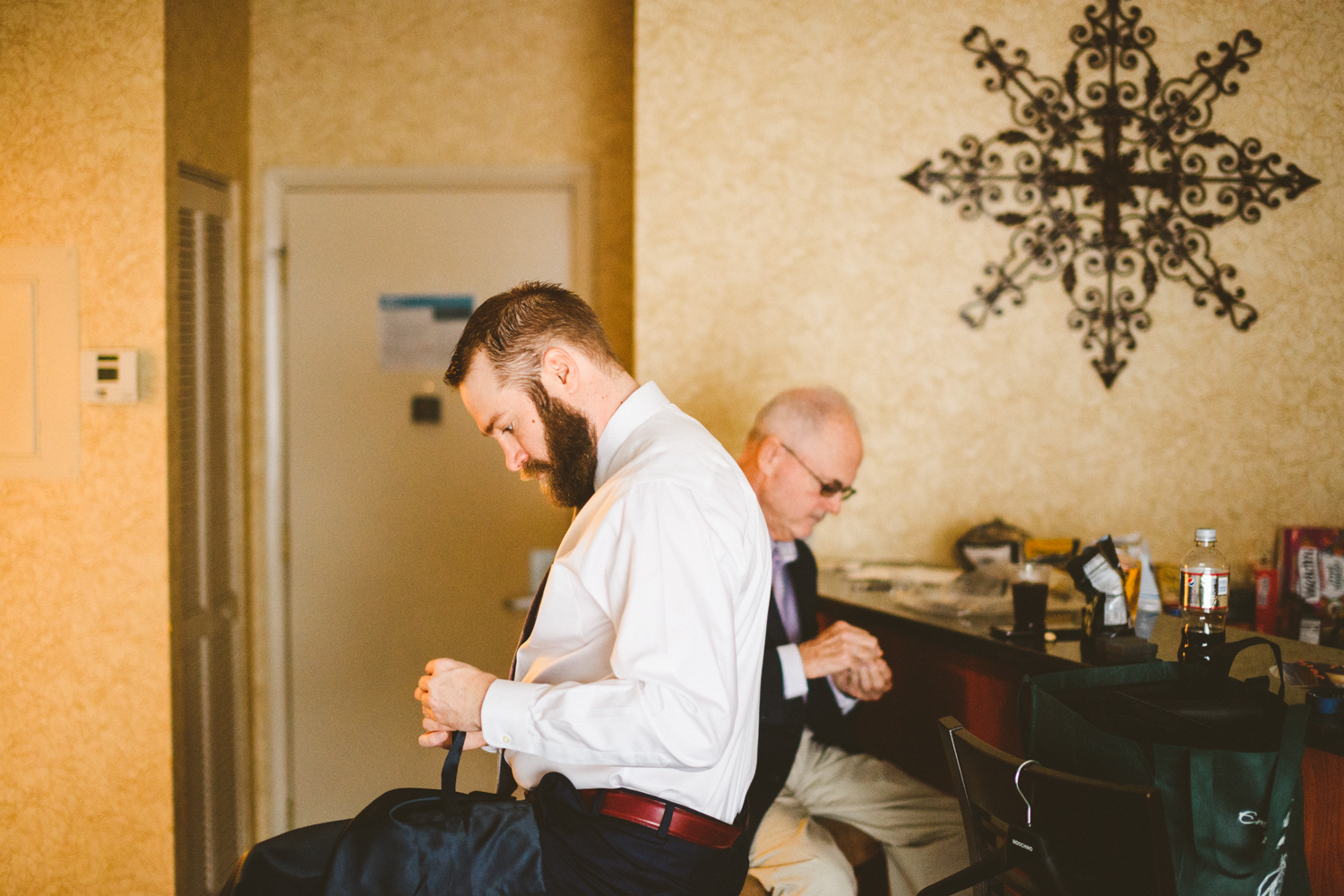 010 - groom and groom's father getting ready in groom's suite.jpg