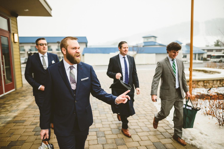 015 - groom being funny as he walks with his groomsmen.jpg
