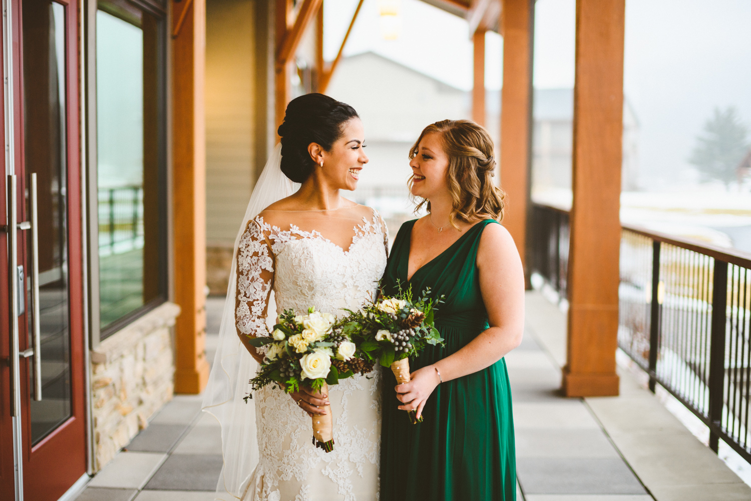 022 - bride and sister of the bride laugh together.jpg