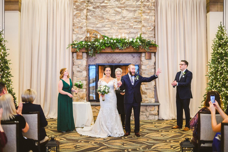 028 - groom cheers as he exits his wedding.jpg