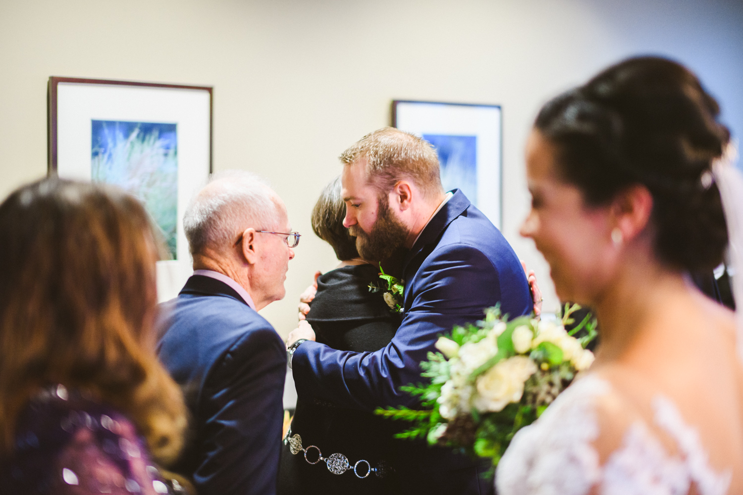 029 - groom embraces parents at liberty mountain resort.jpg