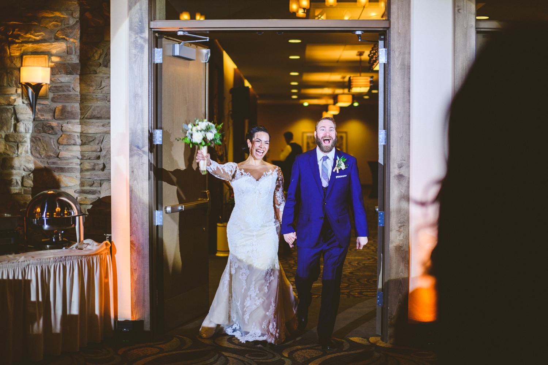 038 - bride and groom enter their wedding reception.jpg