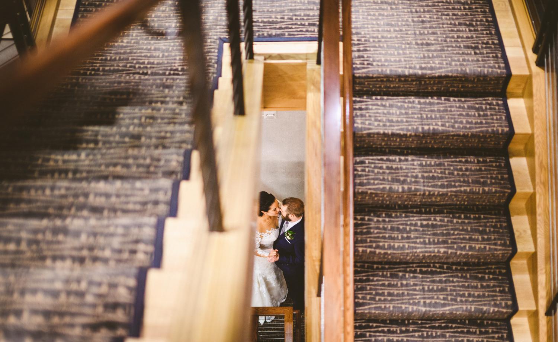 046 - portrait of bride and groom in stairwell.jpg