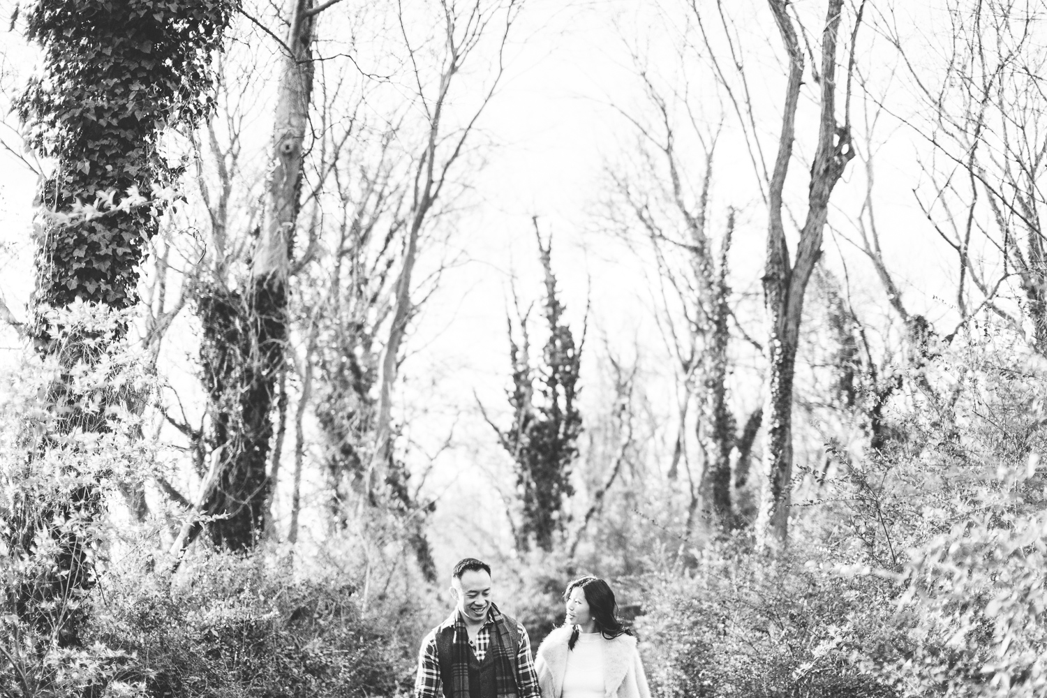 008 - black and white portrait of couple walking through forest together.jpg