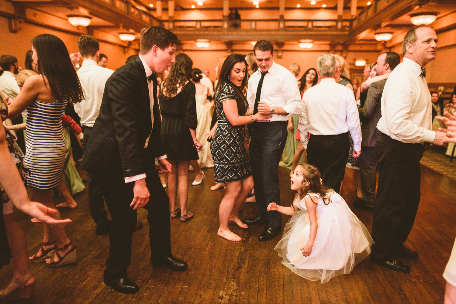 026 - groom and kid laughing at each other during wedding reception.jpg