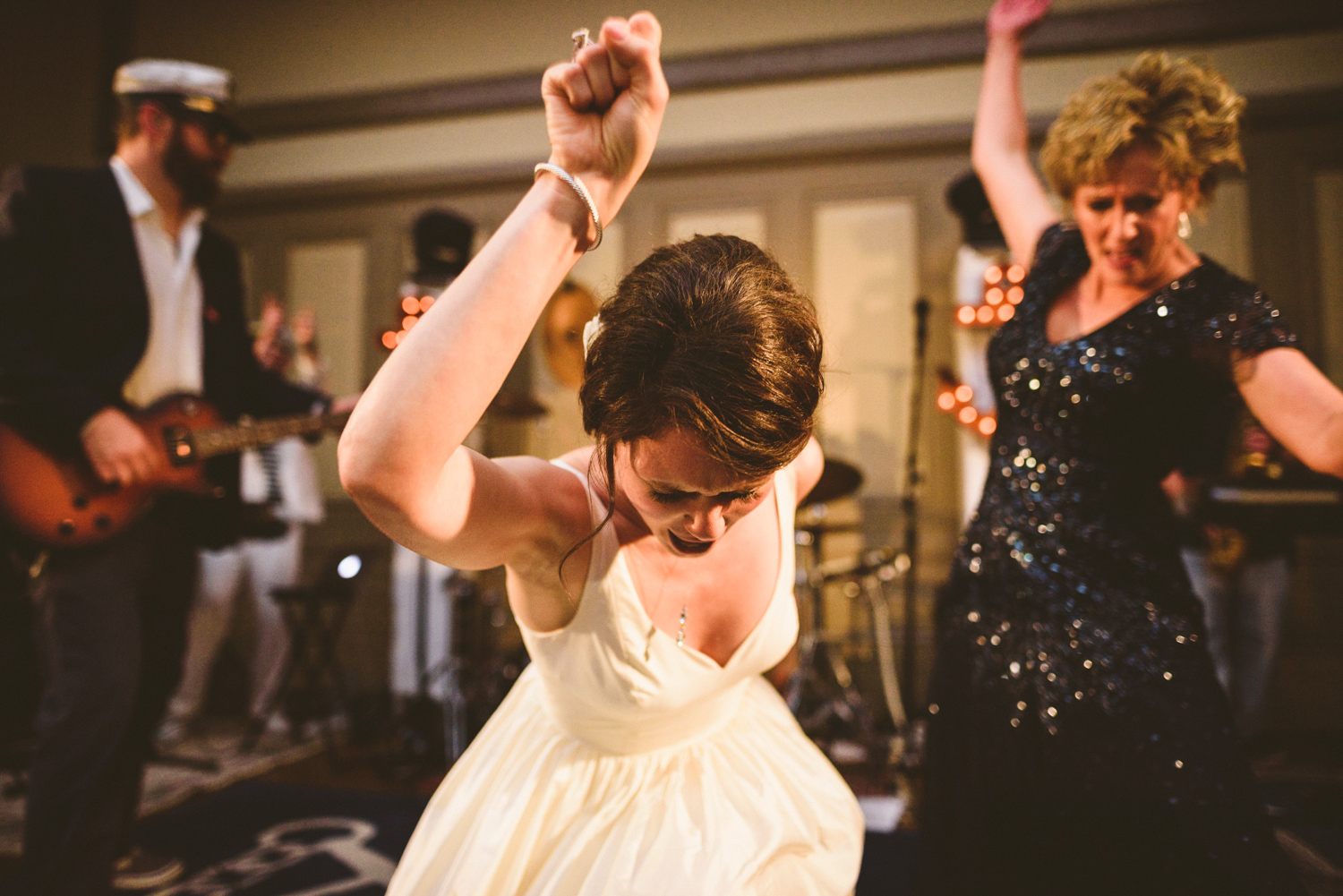 029 - bride dancing on stage with three sheets to the wind wedding band - richmond wedding photographer nathan mitchell.jpg