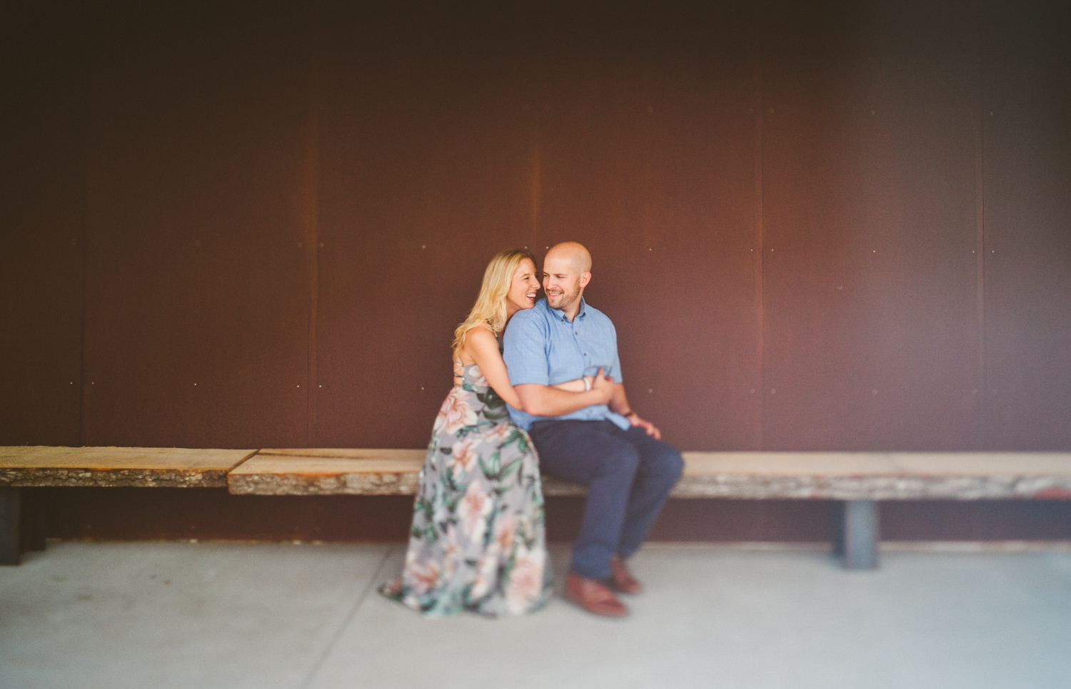 010 - freelens richmond engagement photo against red wall.jpg