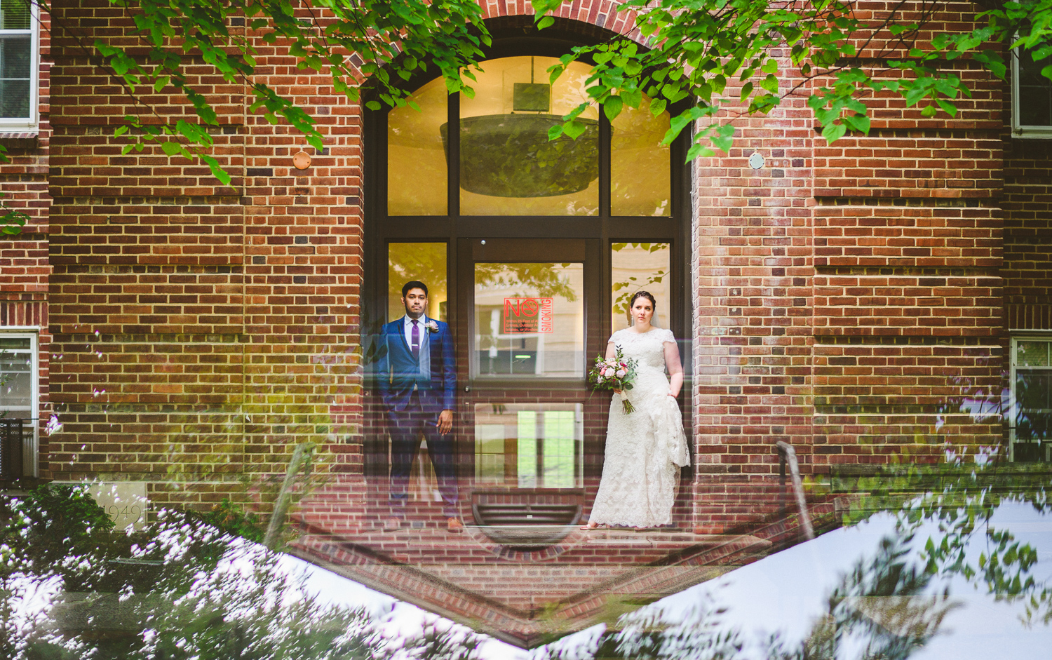 010 - photo of bride and groom in reflection of building.jpg