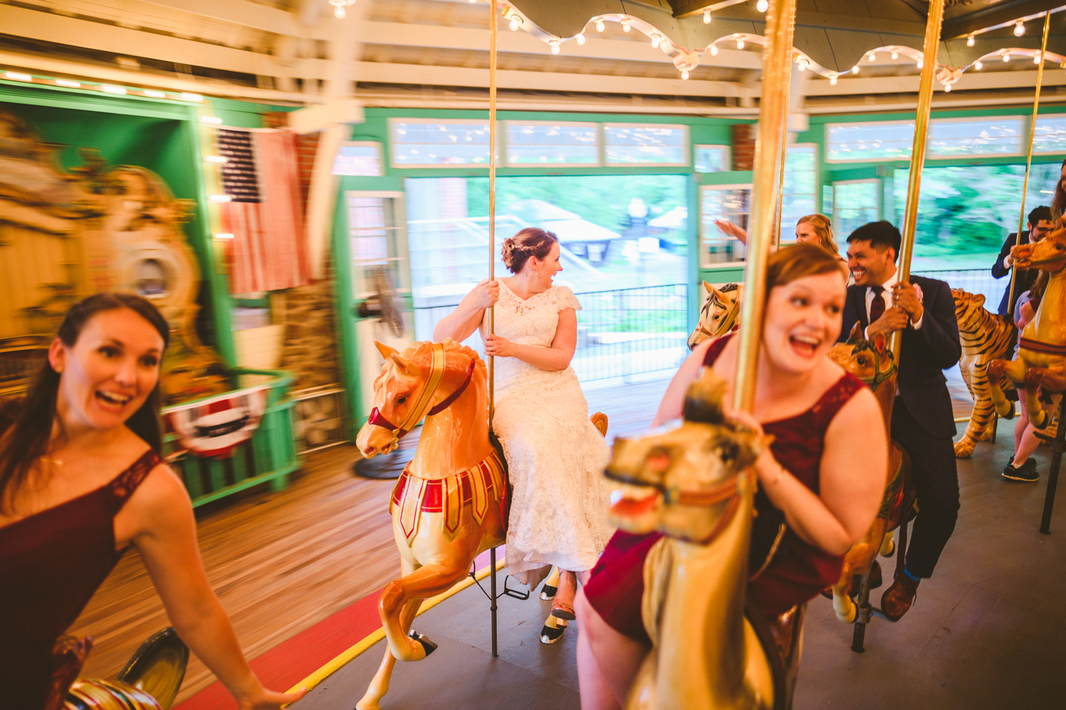 014 - bride and bridesmaids on carousel at glen echo park in maryland.jpg