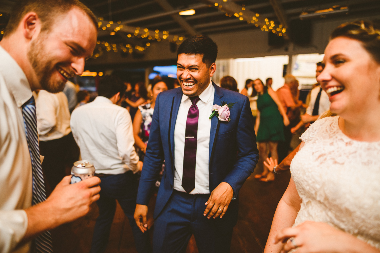 017 - bride and groom dance and laugh with guests at their wedding in washington dc.jpg