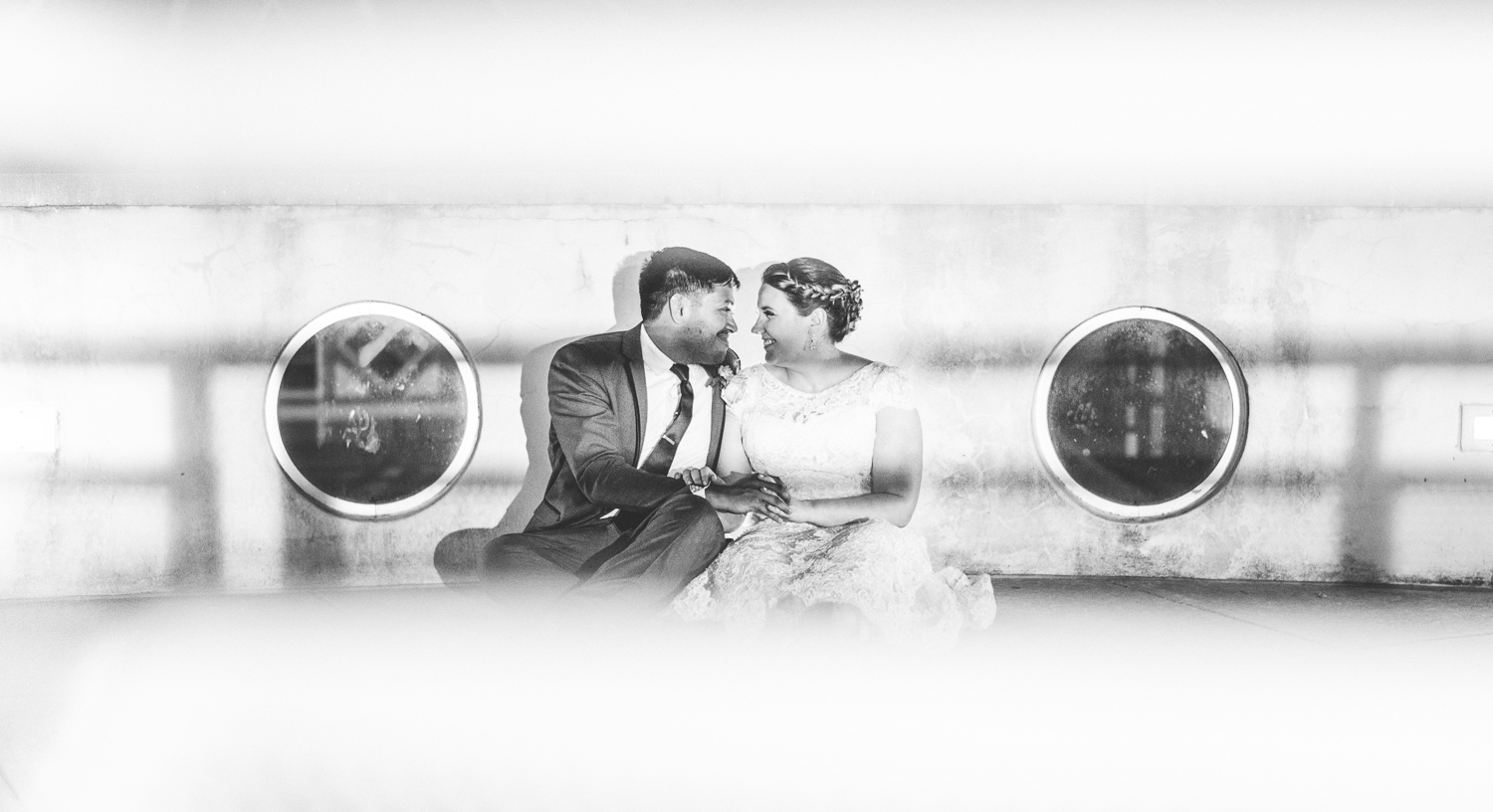 025 - black and white photo of bride and groom sitting down for a night portrait.jpg