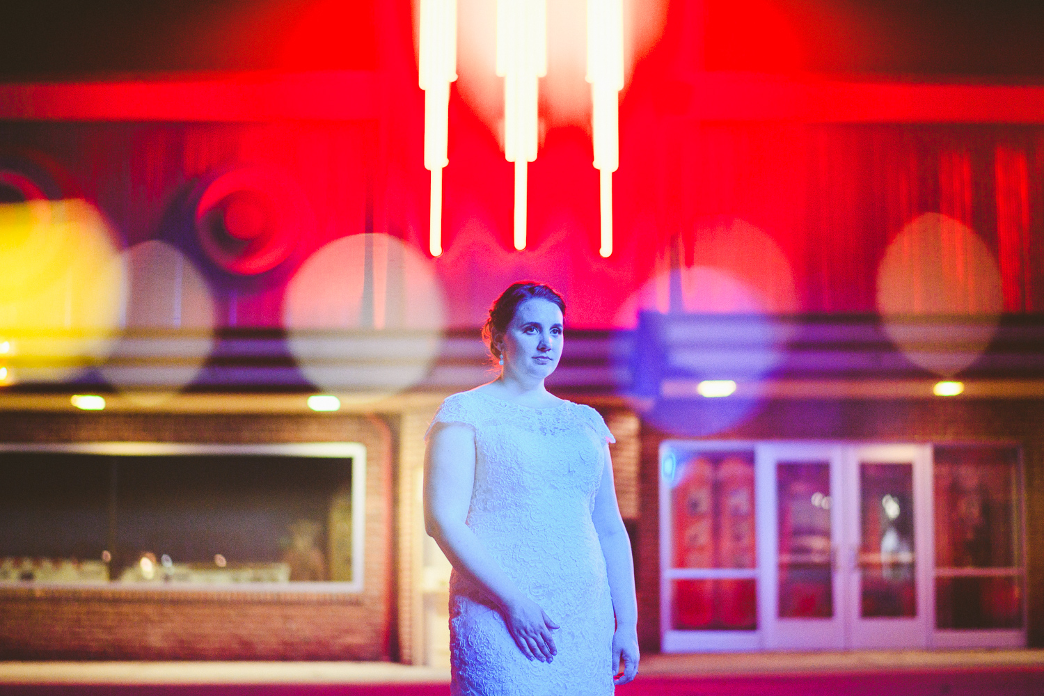 026 - colorful creative wedding portrait of bride at night at glen echo park.jpg