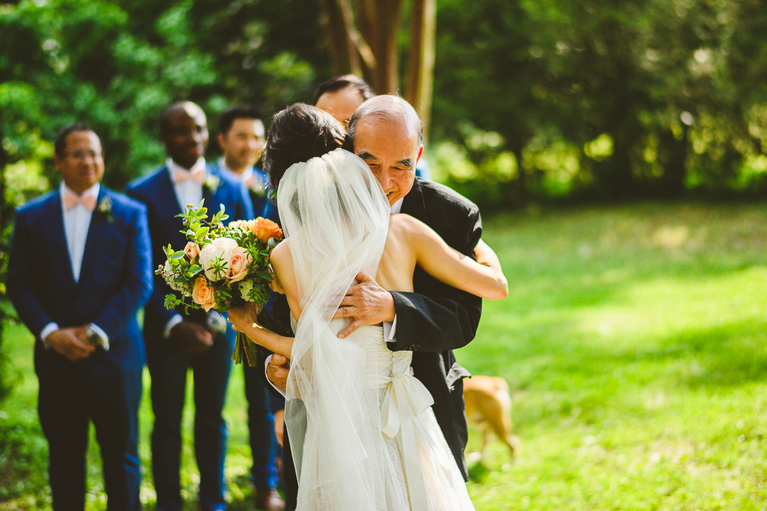 027 - father of the bride hugging the bride at a wedding ceremony.jpg