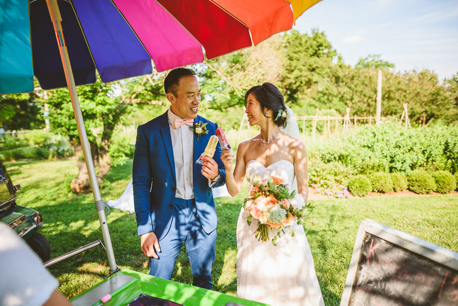 044 - bride and groom eat king of pops popsicles at their wedding in virginia.jpg