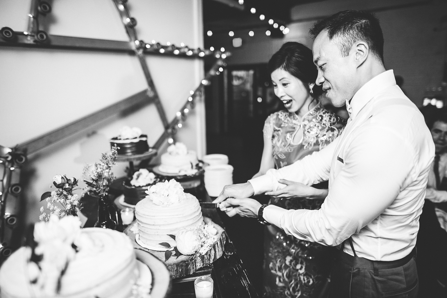 052 - black and white cake cutting at urban roost in richmond virginia.jpg