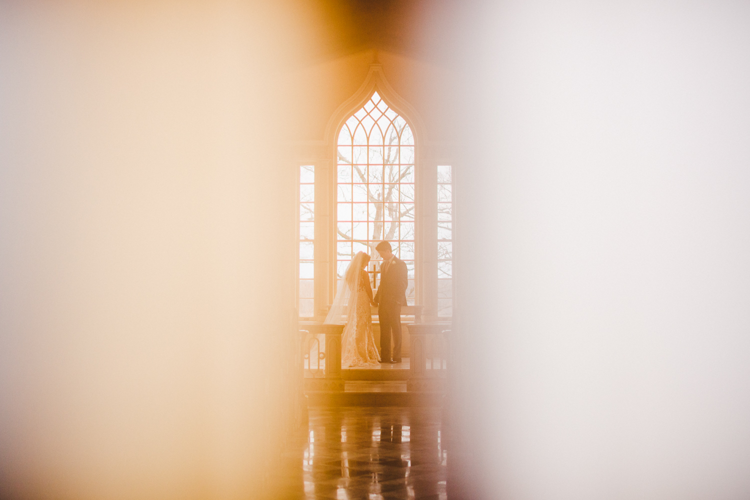 016 - awesome portrait of bride and groom in chapel.jpg