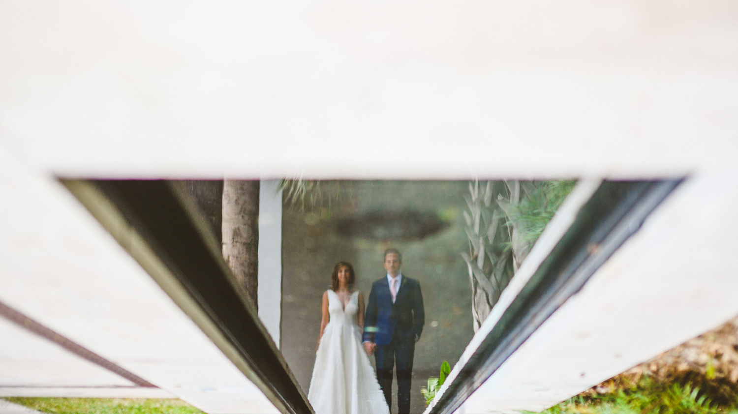 035 - creative portrait of bride and groom reflection in pool.jpg