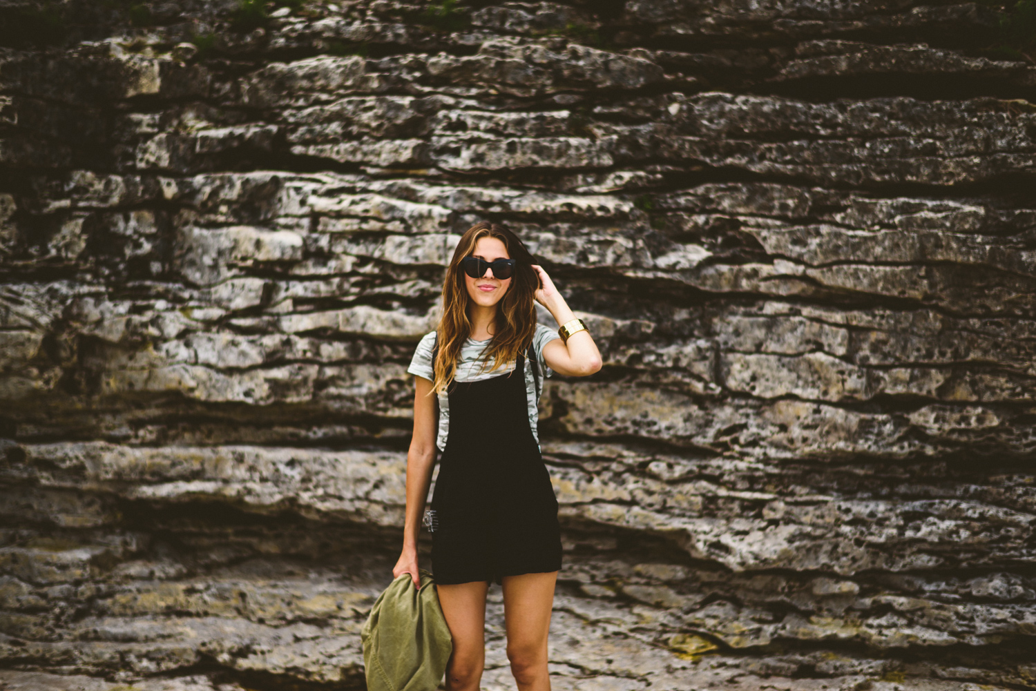 046 - sunglasses girl in front of rocks.jpg
