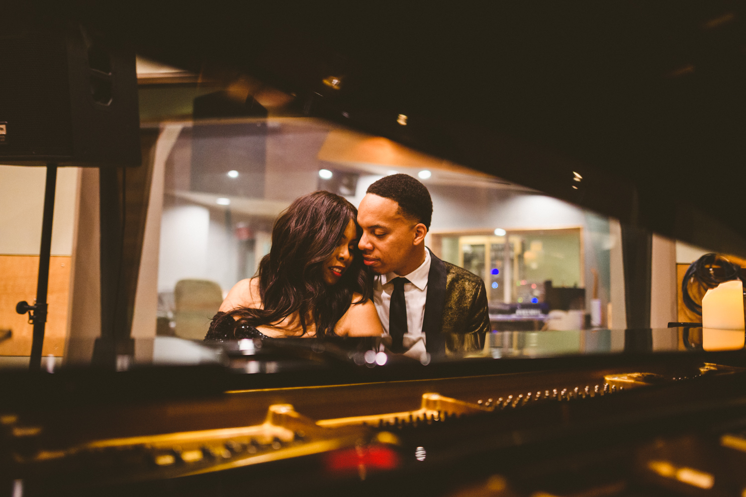 054 - couple in love looking at each other in front of piano in recording studio.jpg