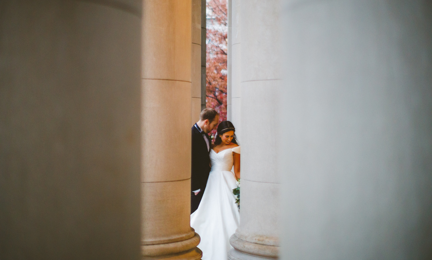 090 - bride and groom in between columns.jpg