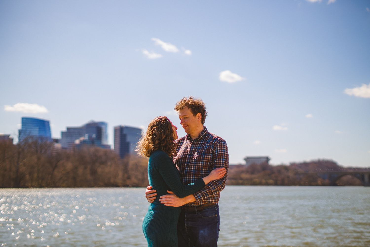 007 - portrait of engaged couple in front of potomac river in georgetown dc.jpg
