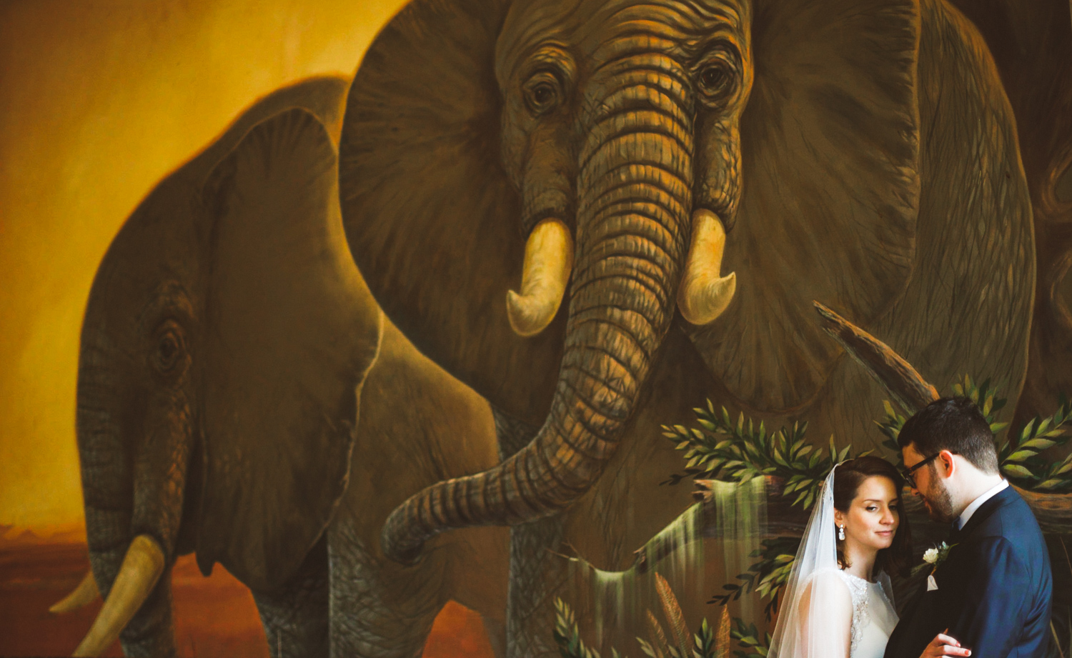 016 - bride and groom portrait in front of elephant mural.jpg