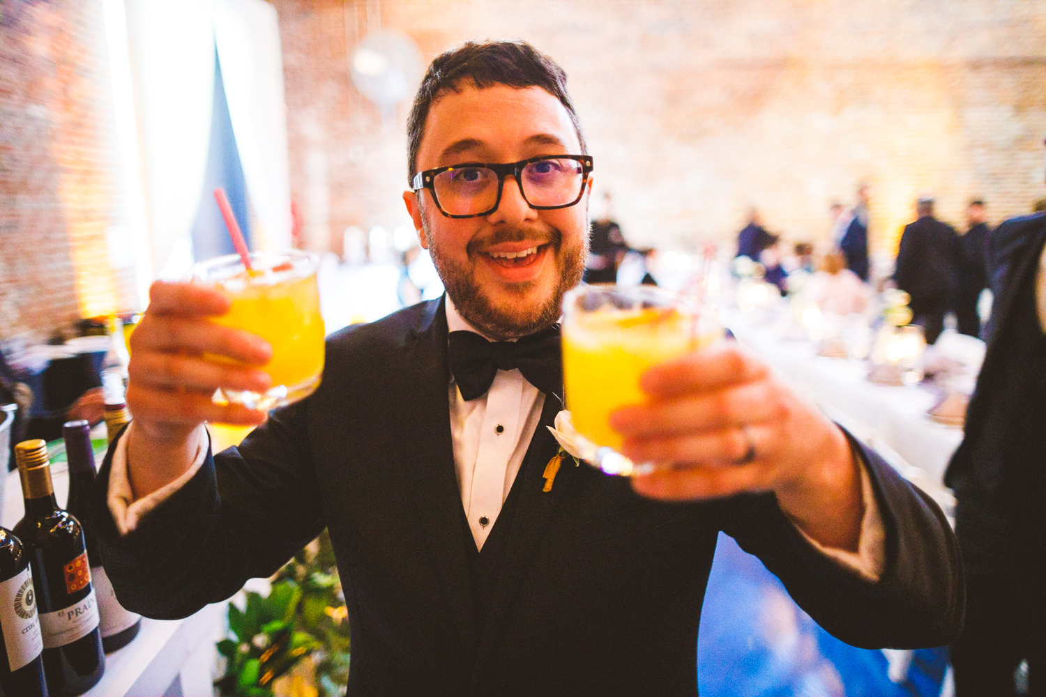 037 - a very baltimore wedding - groom holding two orange crushes.jpg