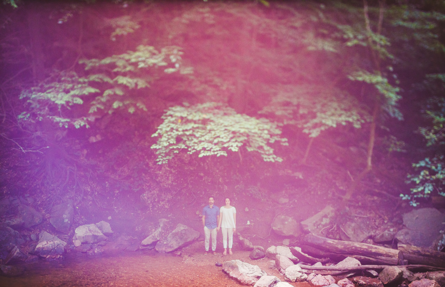 006 - creative engagement photo of couple with pink and green hues.jpg