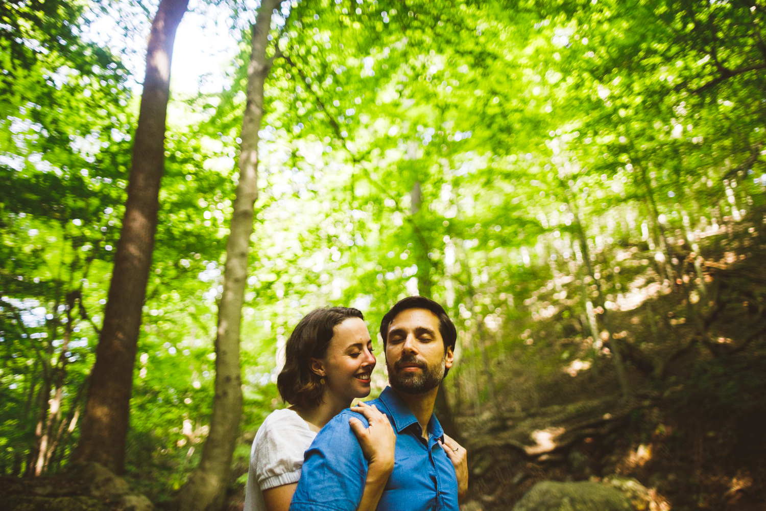 008 - woman hugs man on their engagement session in a maryland state park.jpg