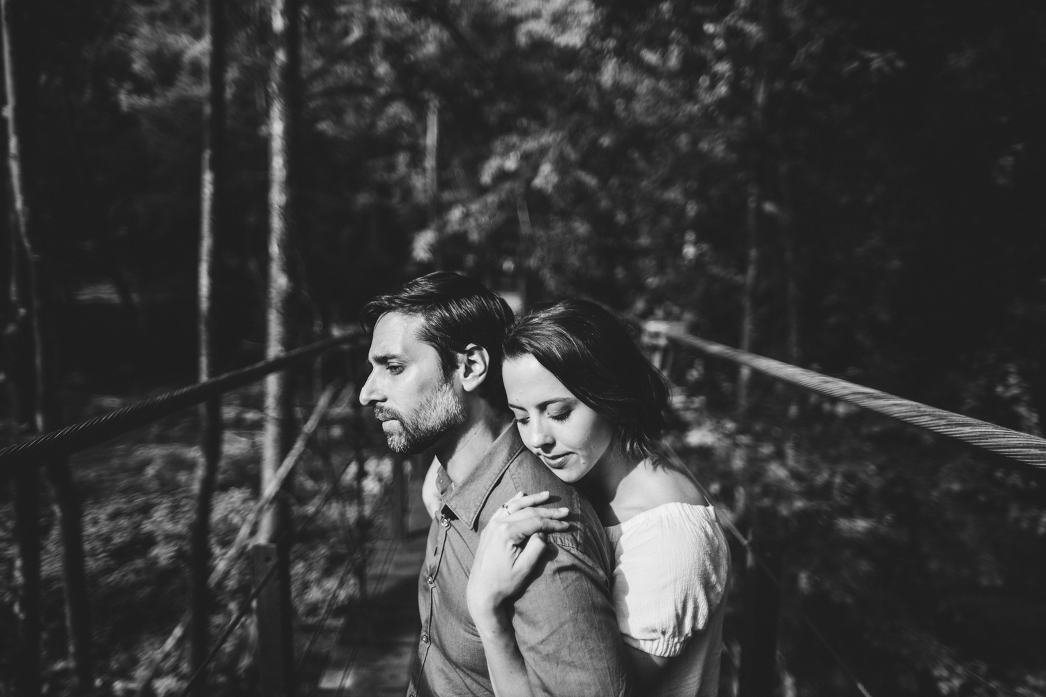 017 - couple hugs on a pretty walking bridge engagement session.jpg