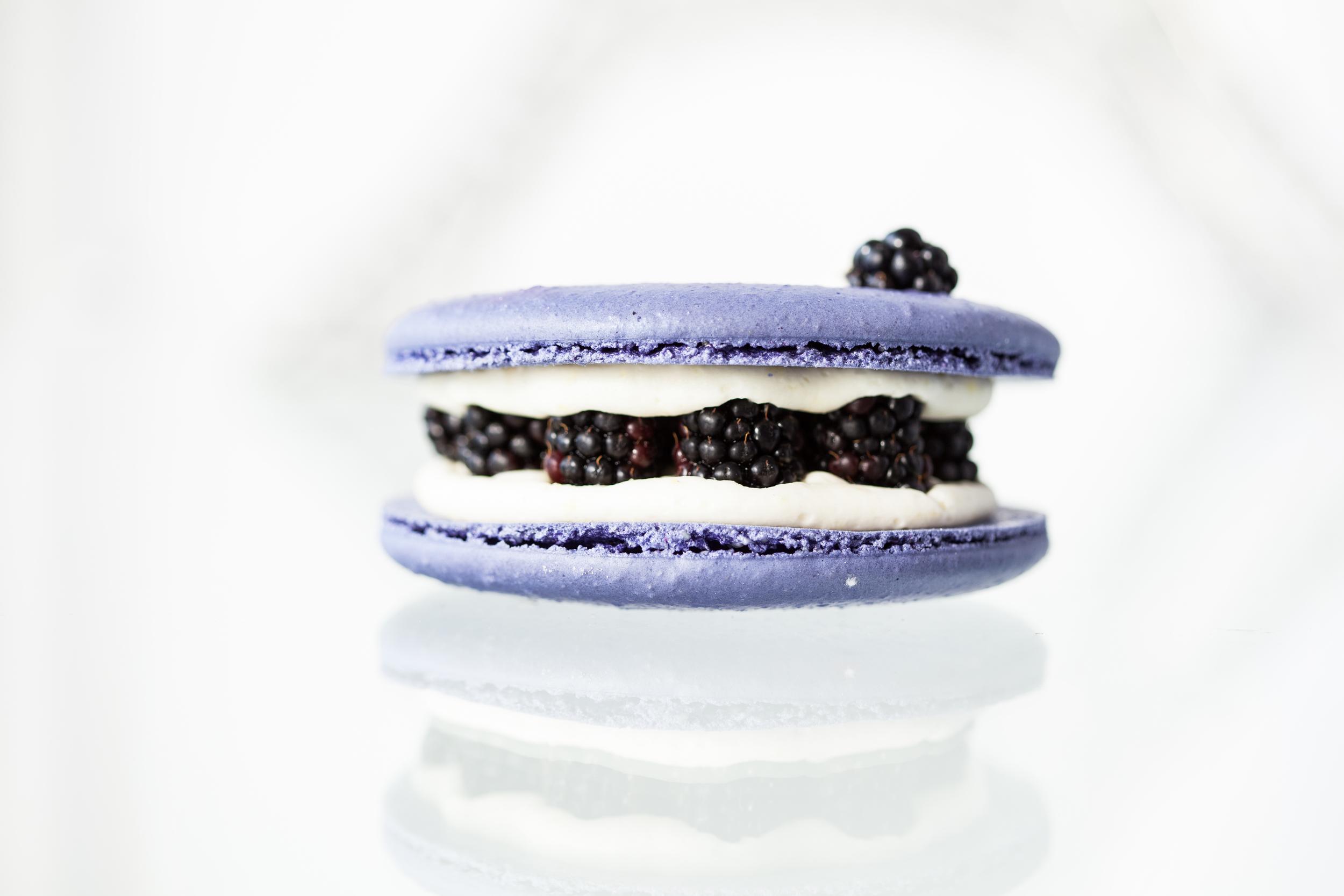 A lightly lavender shell with fresh blackberries in a lemon buttercream.
