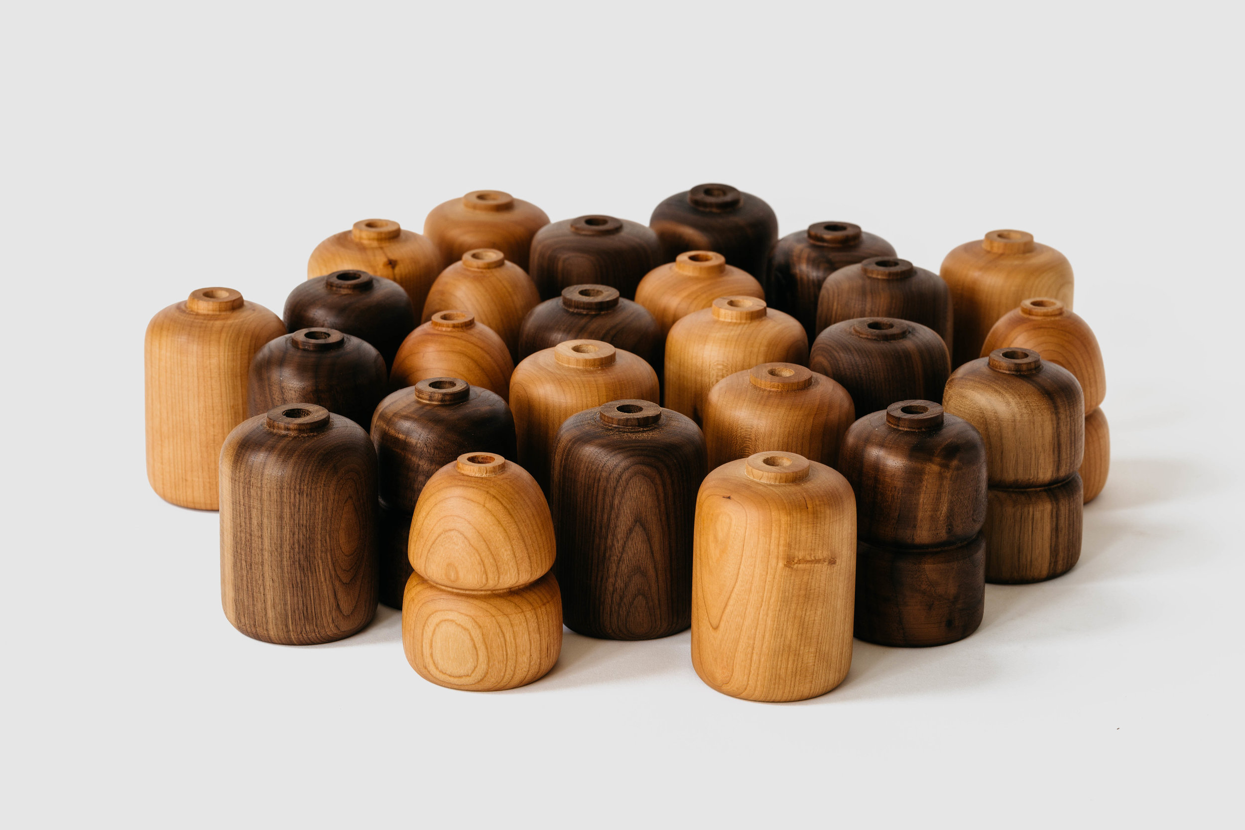 Hardwood Bud Vases   is a unique piece to for anyone that loves fresh flowers in their home. To make it even that much more special, give this gift together with flowers from a local florist!  $60-$75