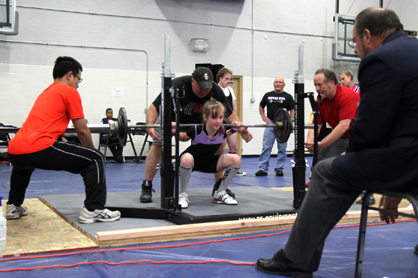 Valarie squats 52.5 kilos (115 pounds) for a new state record.
