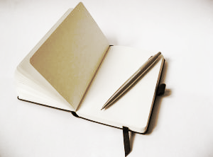 1176000_black_notebook_with_pencil.jpg
