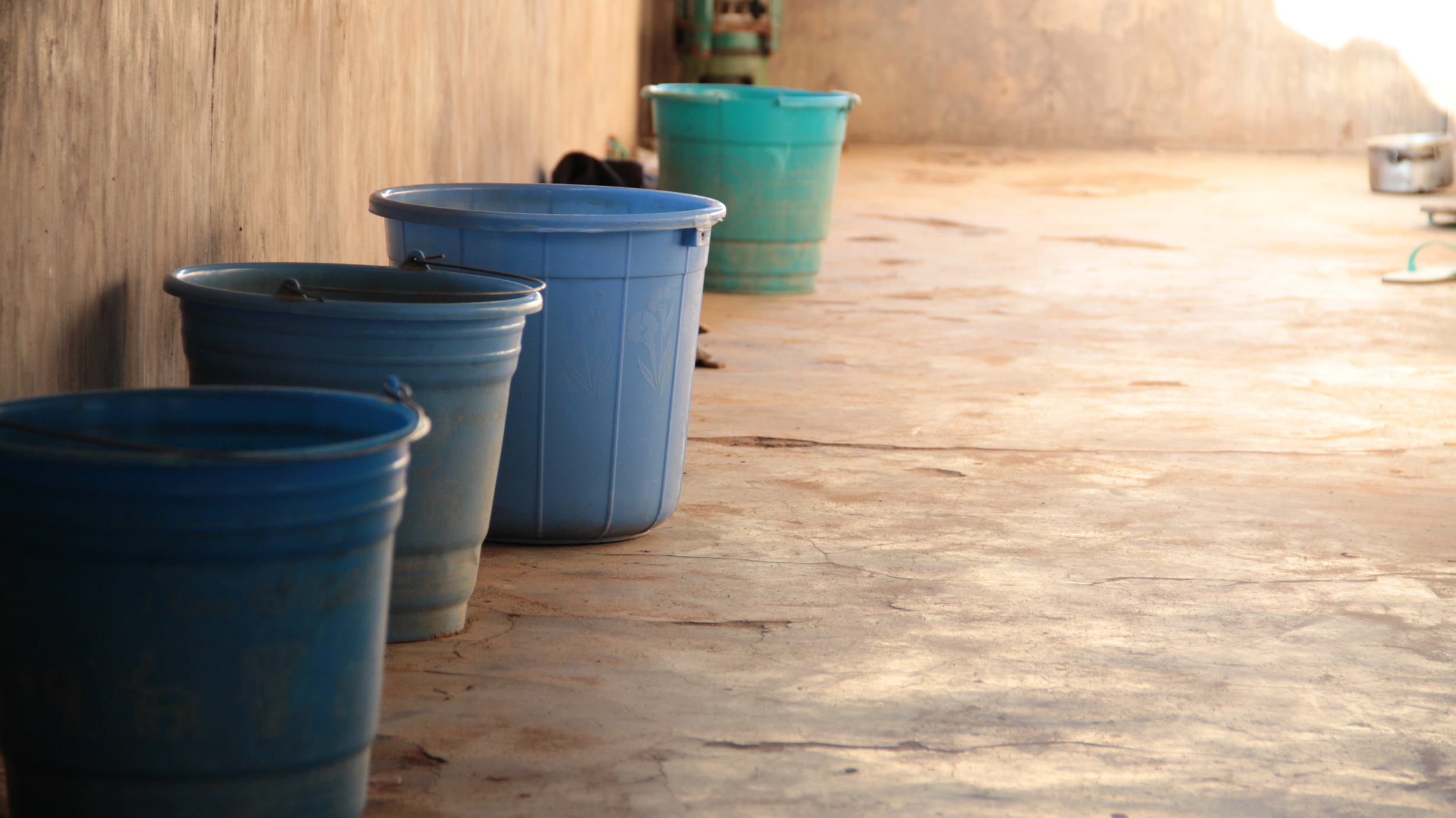 "Water pails on the veranda at ""the monastery""."