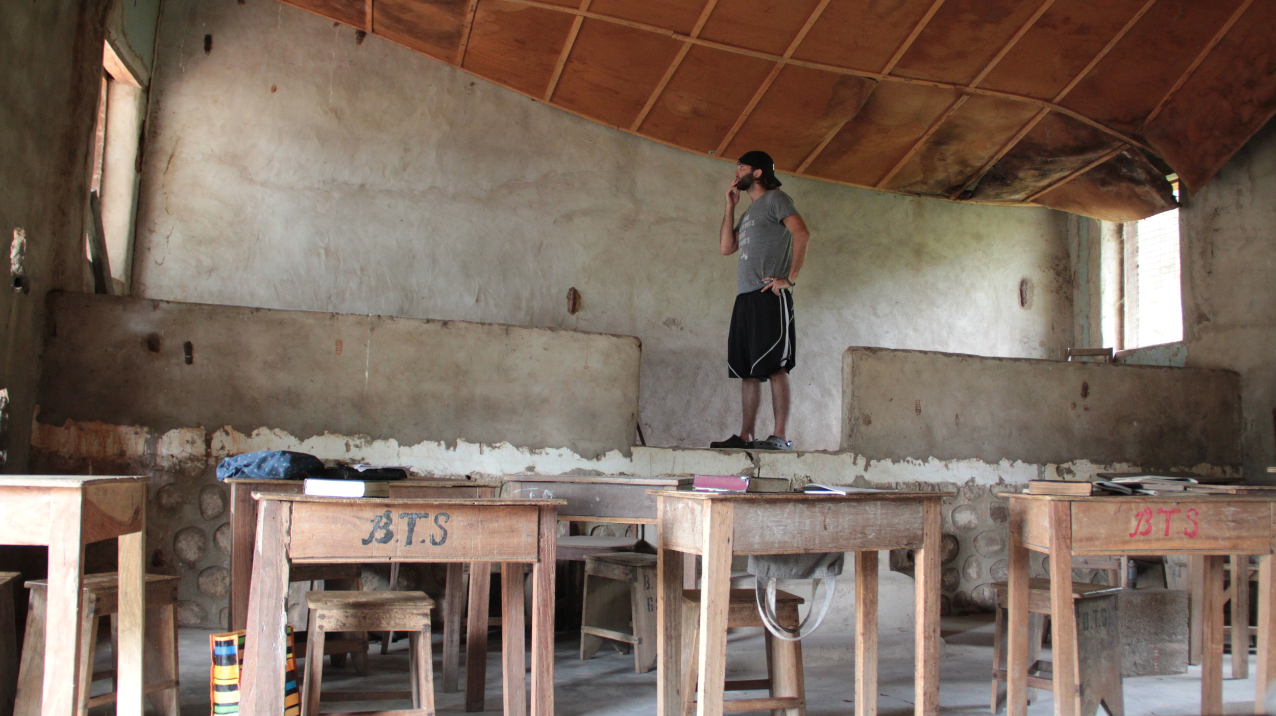 The hot & humid climate is hard on buildings.Here, a ceiling is rotting and collapsing in a classroom.