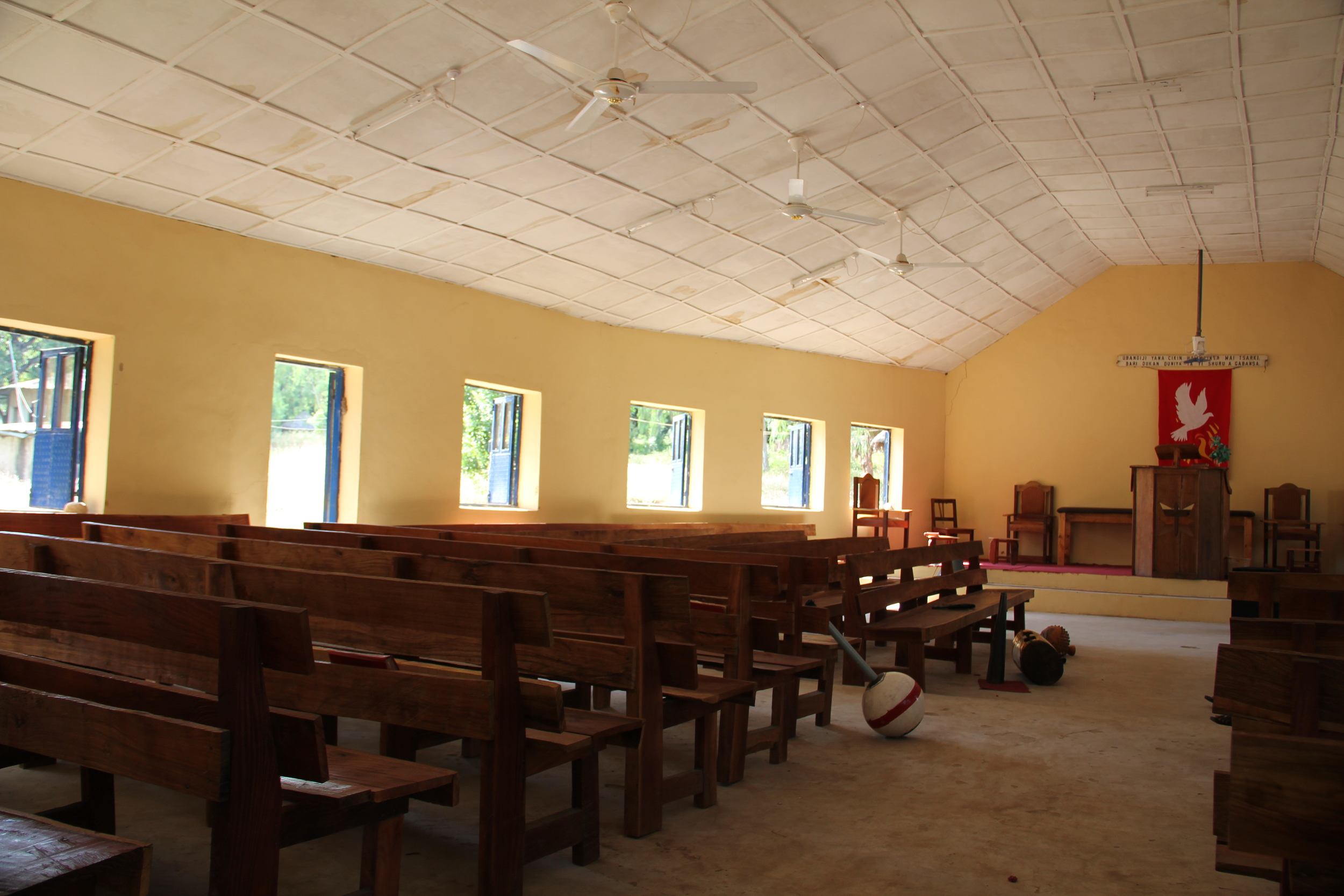 Slightly bowed walls and lots of open windows are designed to catch any available breeze to make worship more comfortable.