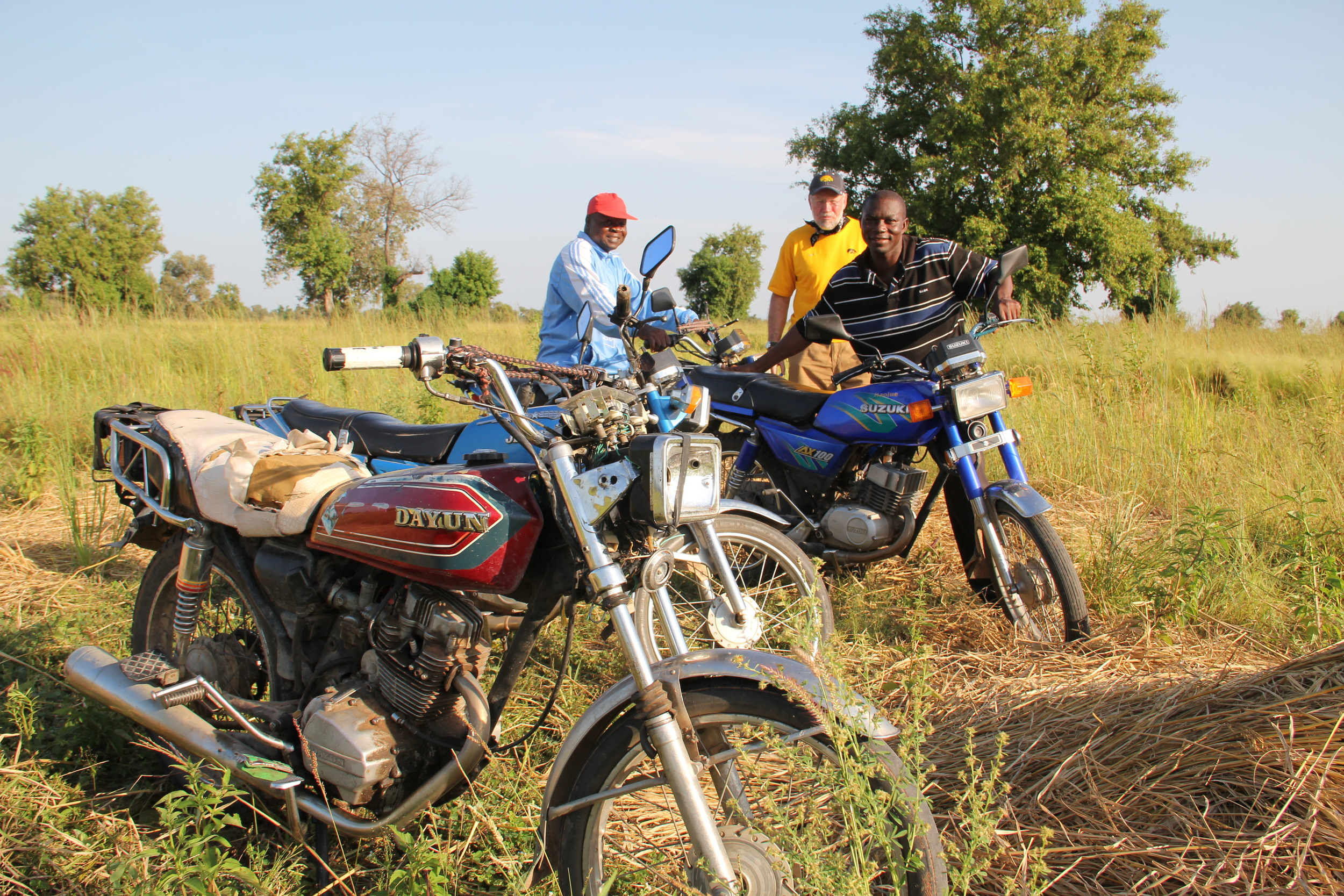 Bikes on the farm.  Seed and harvested crops are both transported on the backs of motorbikes.