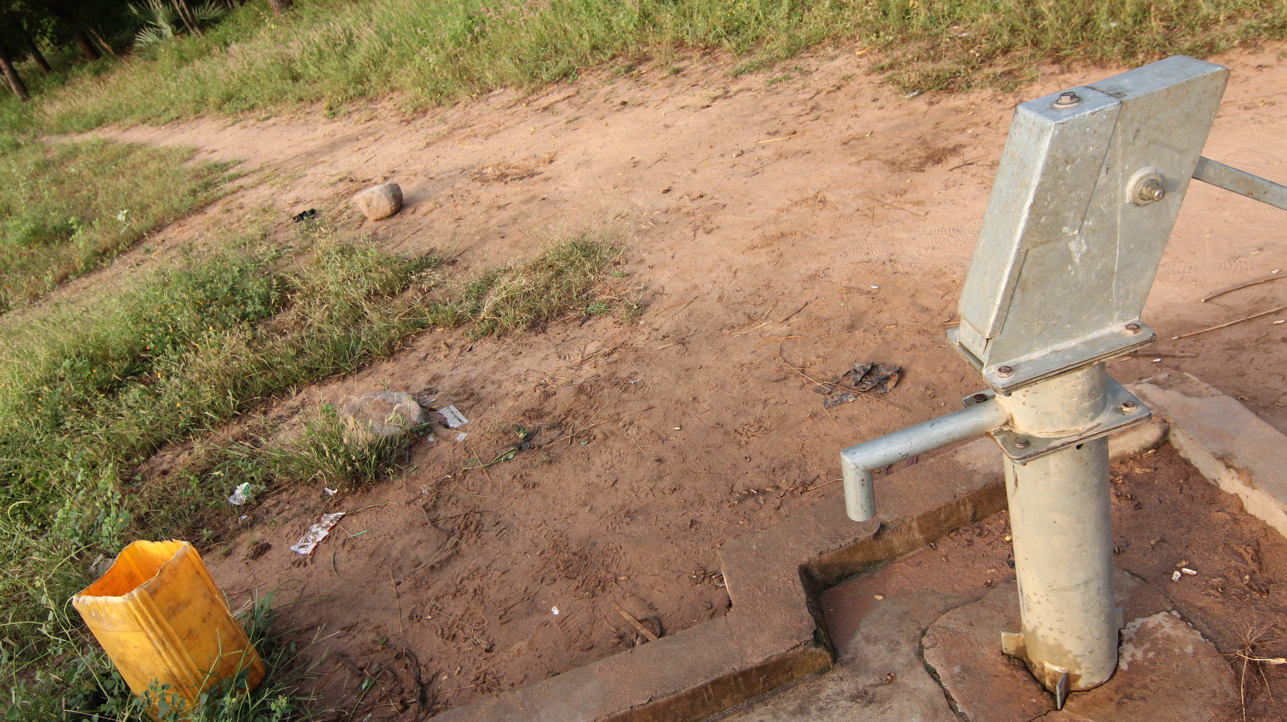 Student's first choice for water is at one of the hand-pump wells that are on-campus.