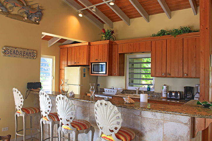 Full Kitchen with Barstools and Granite Countertops