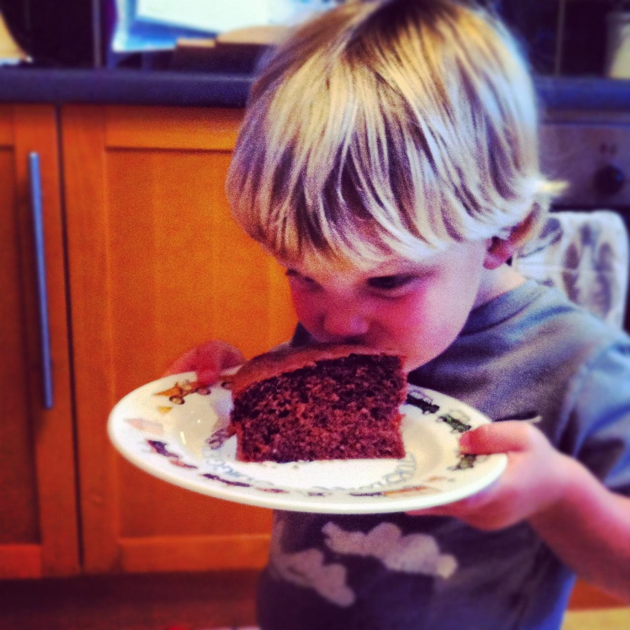 My son Jasper tucking into a piece of chocolate cake, he's showing no signs of eating difficulties!