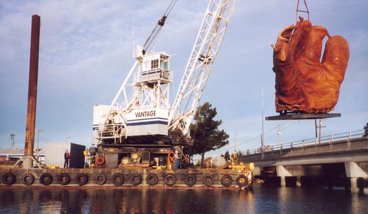 Lifting the giant baseball mitt onto the barge