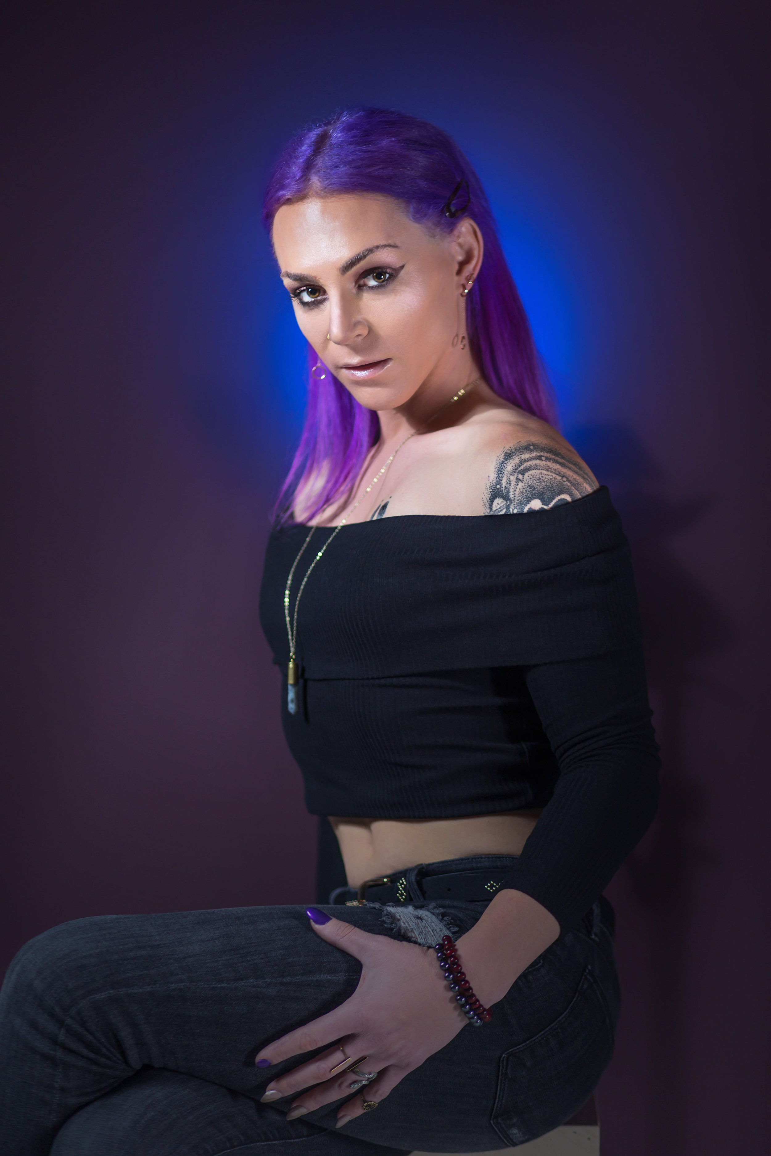 Black top and jeans sitting copy.jpg